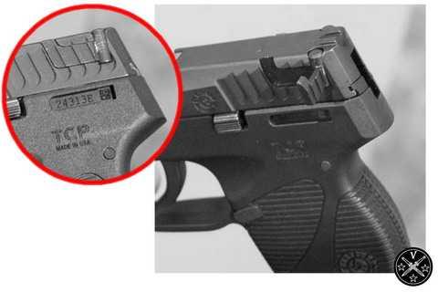 1)Пистолет Taurus с крыльями-ушами